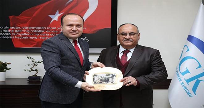 Başkan Hasan Can Sosyal Güvenlik Merkezi Müdürü Olkan Uzman'ı Ziyaret Etti
